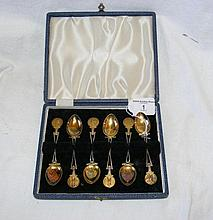 A set of six silver and gilt golf trophy spoons in