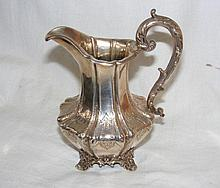 A Victorian chased and engraved silver jug with