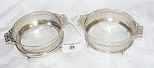 A pair of Edwardian silver wine coasters by