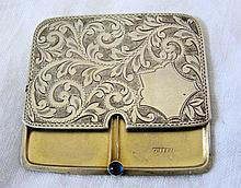 An Edwardian silver stamp case with chased and