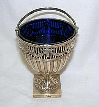 An Edwardian silver sugar basket with blue glass