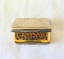 A George III silver vinaigrette with gilt interior