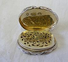 An oval Victorian silver vinaigrette with gilt