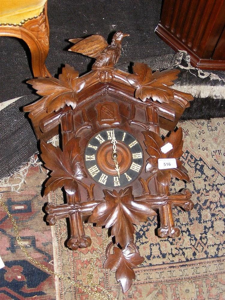 A carved wooden cuckoo clock - Wooden cuckoo clocks ...