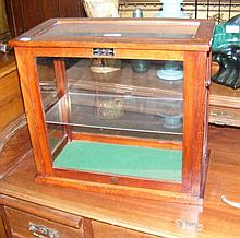 A miniature display cabinet with sliding front