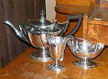 A three piece silver teaset of elegant design,