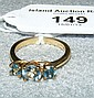 A 10ct gold three stone aqua marine and zircon
