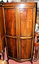 An 80cm wide mahogany bow front hanging robe,