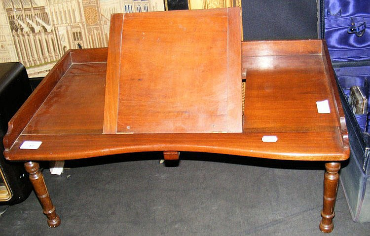 A Victorian mahogany bed table with hinged book