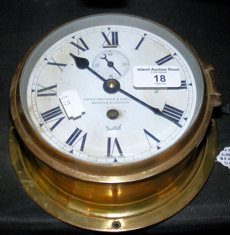 A Sestrel brass cased bulkhead clock with eight