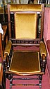 A mahogany framed American rocking armchair with