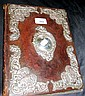 An ornate silver and leather desk folder -