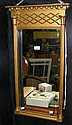 An antique gilt hall mirror