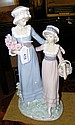 A large Lladro china ornament of two young ladies