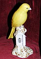 A Royal Worcester bright yellow Canary on stump -