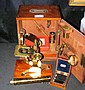 An antique microscope with fitted mahogany case