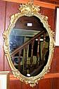 A decorative gilt wall mirror - 78cm