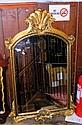 An antique style gilt framed hall mirror