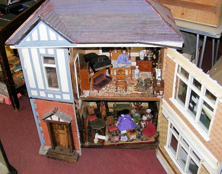 A Large Antique Wooden Dolls House With Fully Fitted Interio