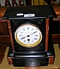 A slate and variegated marble cased mantel clock