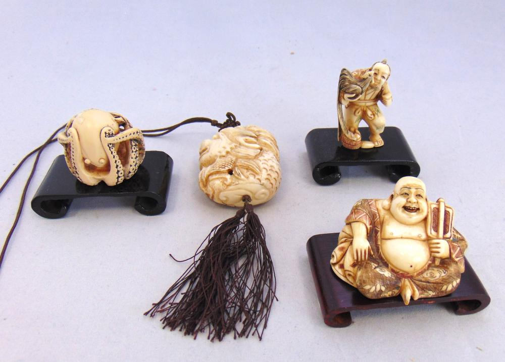Four carved Netsuke figurines
