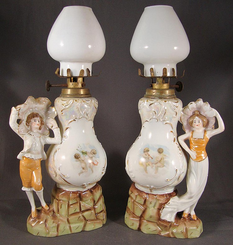 PORCELAIN LADY AND MAN FIGURAL PAIR OF MINIATURE LAMPS