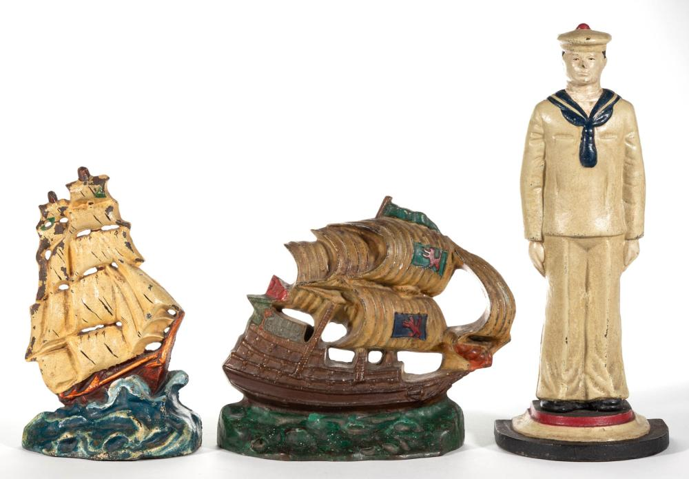 CAST-IRON FIGURAL SAILING-THEMED DOORSTOPS, LOT OF THREE