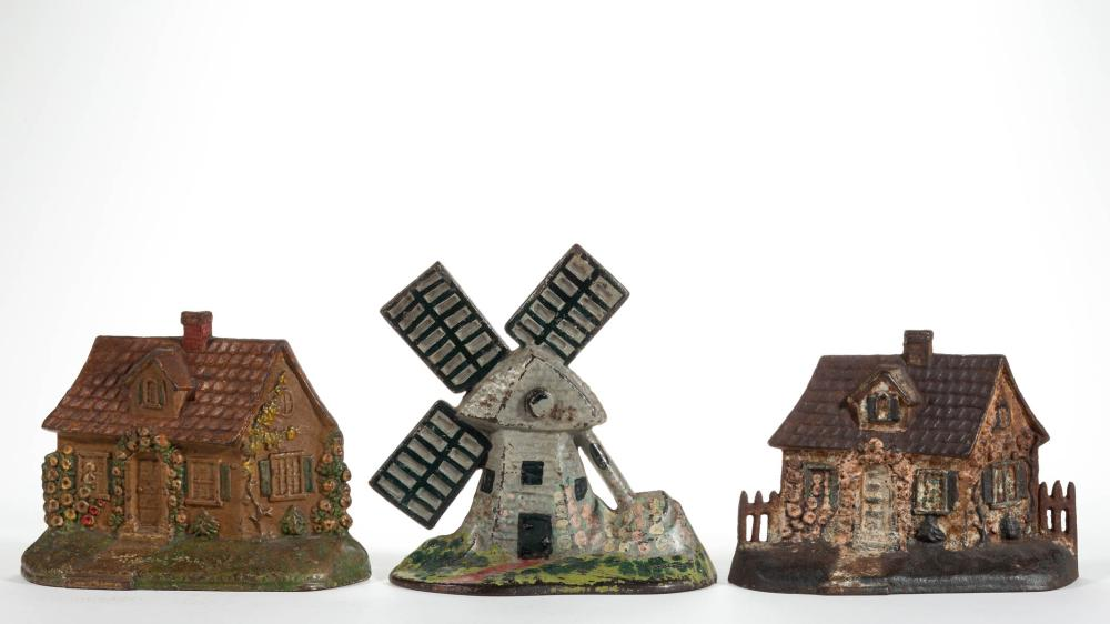 CAST-IRON FIGURAL WINDMILL AND COTTAGE DOORSTOPS, LOT OF THREE