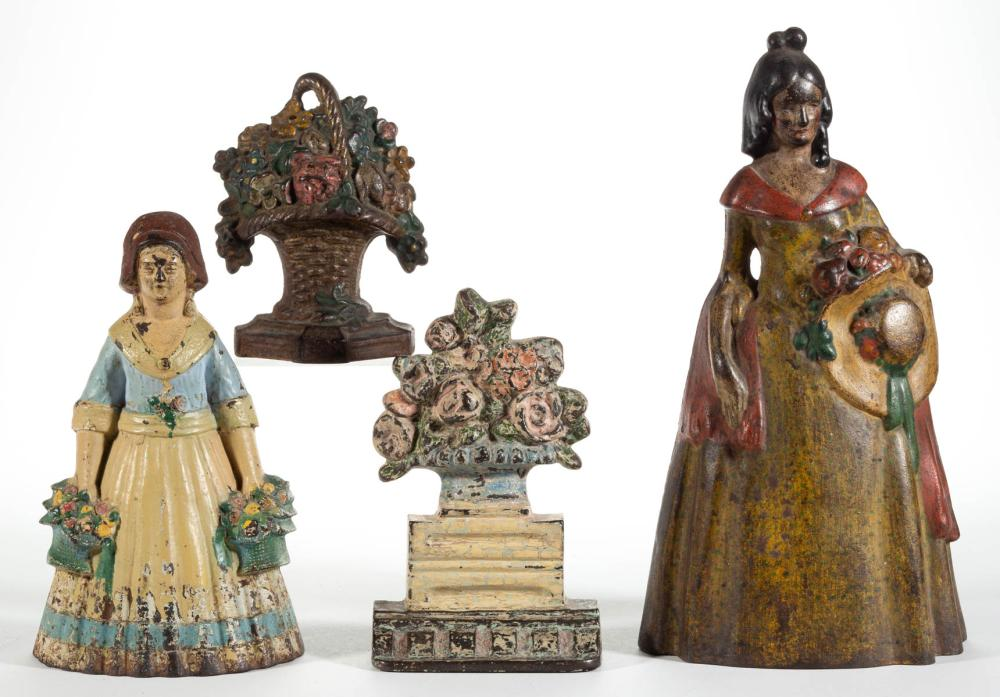 CAST-IRON FIGURAL LADY AND FLOWER DOORSTOPS, LOT OF FOUR