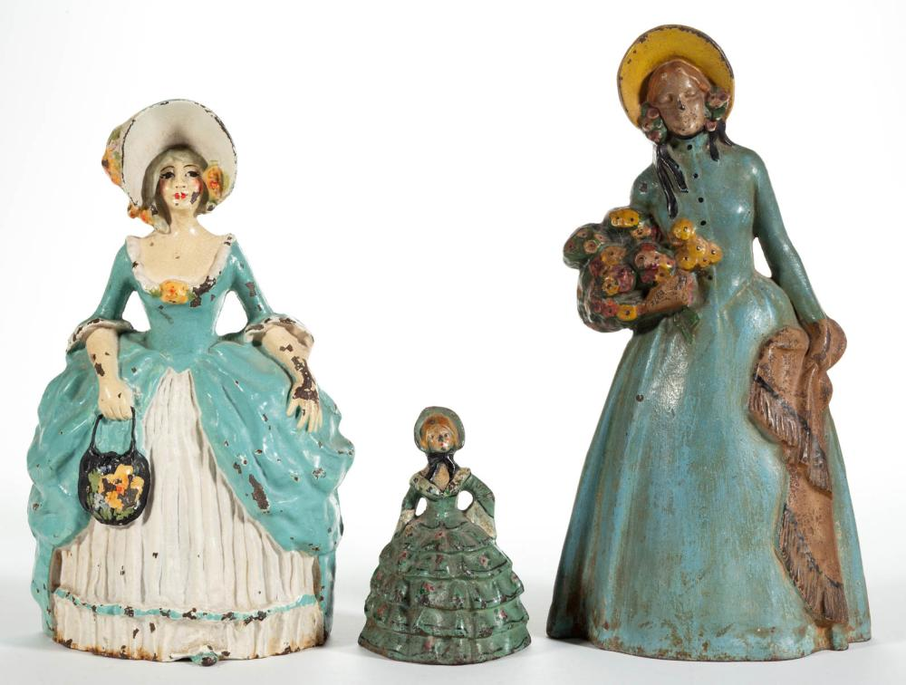 CAST-IRON FIGURAL LADY DOORSTOPS, LOT OF THREE