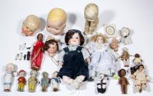 ASSORTED PORCELAIN AND OTHER DOLLS AND RELATED ARTICLES, LOT OF 25