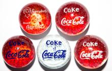 ASSORTED COCA-COLA ADVERTISING FRIT PAPERWEIGHTS, LOT OF FIVE