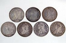 UNITED STATES SILVER CAPPED BUST HALF DOLLAR COINS, LOT OF SEVEN