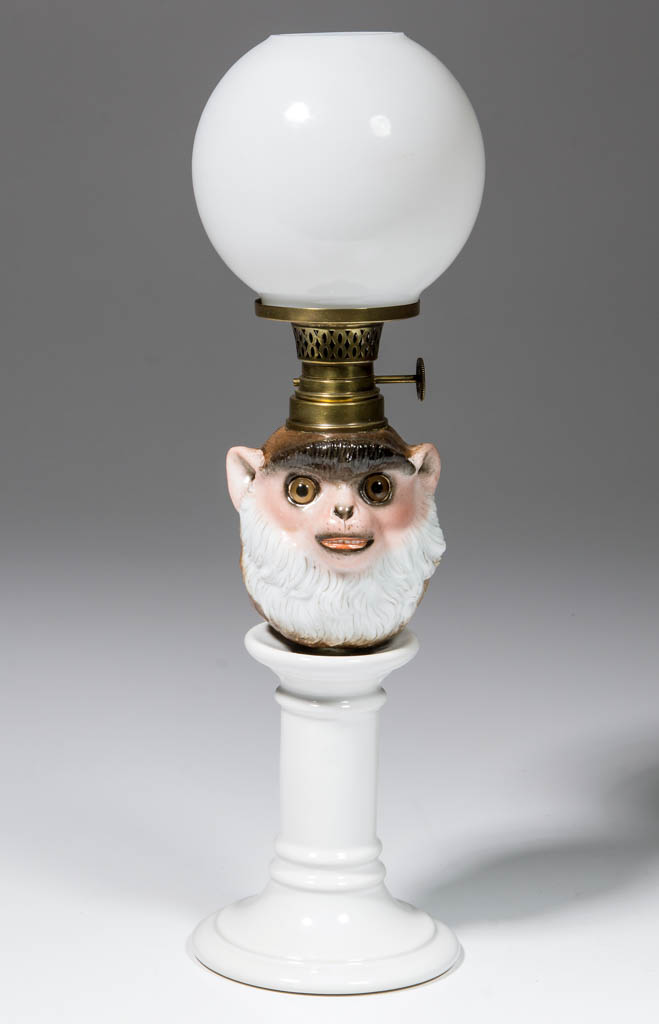 PORCELAIN SMILING MONKEY HEAD FIGURAL MINIATURE PEG LAMP