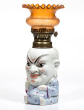 PORCELAIN SITTING MAN FIGURAL MINIATURE LAMP