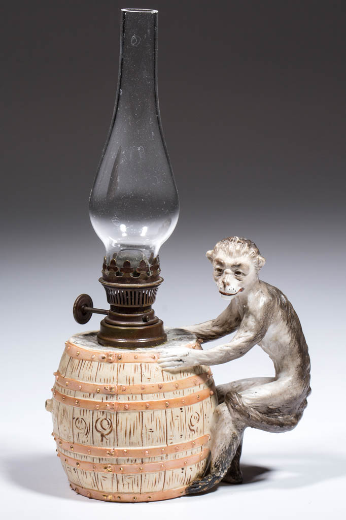PORCELAIN MONKEY WITH BARREL FIGURAL MINIATURE LAMP