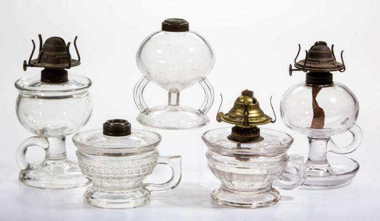 ASSORTED PATTERN KEROSENE FOOTED FINGER LAMPS, LOT OF FIVE