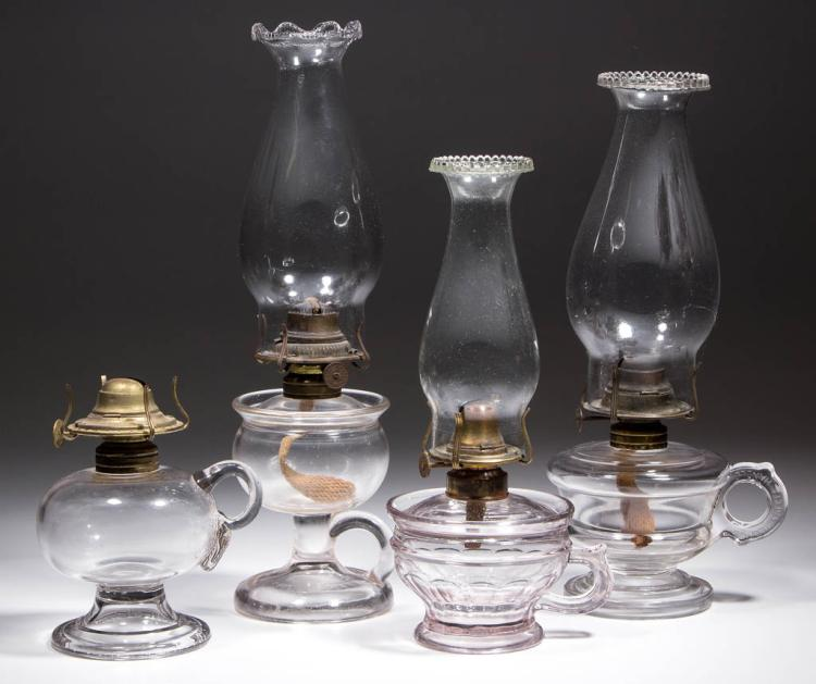 ASSORTED PATENTED AND OTHER PATTERN KEROSENE FOOTED FINGER LAMPS, LOT OF FOUR