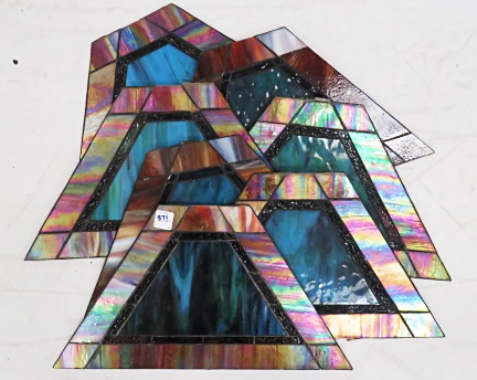 LOT (7) SLAG AND IRIDESCENT GLASS TRAPEZOIDAL PANELS. 10 X 17 1/2