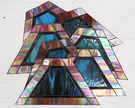 LOT (7) SLAG AND IRIDESCENT GLASS TRAPEZOIDAL PANELS. 10 X 17 1/2