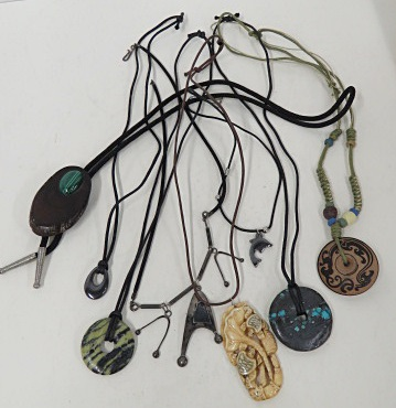 LOT ASSORTED INCLUDING PENDANTS INCLUDING HARDSTONE, PETRIFIED WOOD, JAPANESE BONE AND SILVER WITH SILK/LEATHER CORDS AND (3) MEXICAN ALPACA METAL PANEL NECKLACE, BRACELET AND PAIR SCREW-BACK EARRINGS WITH COPPER AND BRASS HIGHLIGHTS