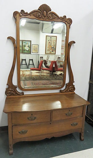 CARVED OAK PRINCESS DRESSER WITH ADJUSTABLE MIRROR. HEIGHT 5'7