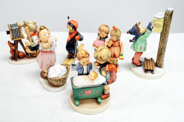 LOT (6) GOEBEL AND HUMMEL PORCELAIN FIGURES INCLUDING LETTER TO SANTA, #340; WASH DAY, #34; BLESSED EVENT, #333; HAPPY BIRTHDAY, #176; SKIER, #59; THE PHOTOGRAPHER, #178