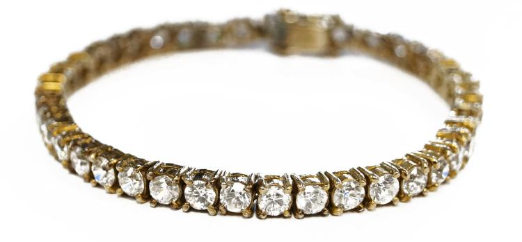 GILT 925 STERLING LINE BRACELET WITH (40) 3.86-4.39MM CUBIC ZIRCONIAS. LENGTH 7