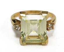 14K YELLOW GOLD AND SYNTHETIC SPINEL RING (SYNTHETIC SPINEL 12.0X 10.0MM). RING SIZE 6 3/4; 21.4 GRAMS