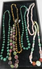 MULTIPLE GEM STONE STRAND NECKLACES INCLUDING TOURMALINE, TIGER'S EYE QUARTZ, FRESHWATER BAROQUE PEARLS, MALACHITE AND AGATE