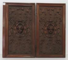 PAIR RENAISSANCE STYLE CARVED WALNUT CUPBOARD DOORS, 19TH CENTURY. HEIGHT 24