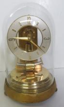 KUNDO BRASS ELECTRONIC SHELF CLOCK WITH GLASS DOME, C.1960'S. HEIGHT 9 3/8