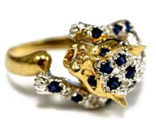 14K/585 YELLOW AND WHITE GOLD DIAMOND AND SAPPHIRE LEOPARD RING (MISSING 1/DIAMOND). RING SIZE 7 1/2; GROSS WEIGHT 4.0 GRAMS