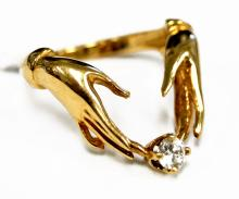 14K YELLOW GOLD 0.23 CT DIAMOND WHIMSICAL HAND-FORM RING. RING SIZE 7; GROSS WEIGHT 5.6 GRAMS